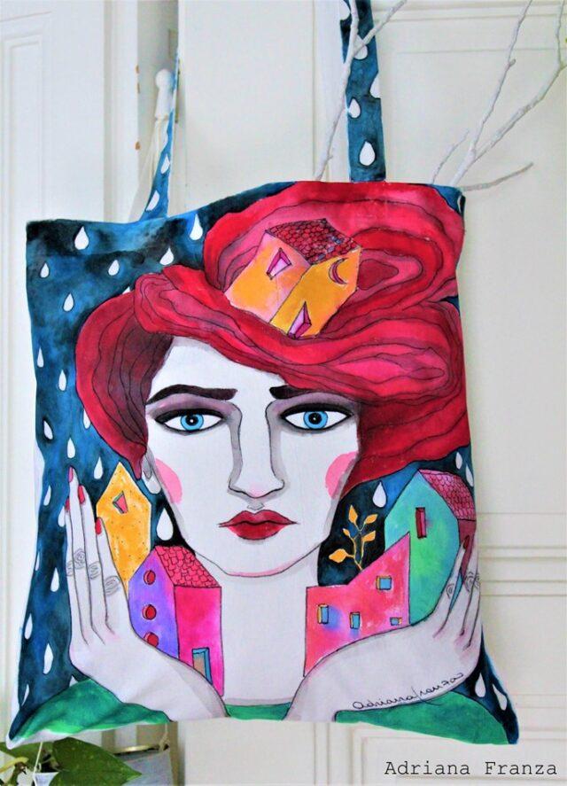 pittura_surrealista-pioggia-capelli_rossi-casette_colorate_città_colorata-borsa_unica-regalo_originale-borsa_dipinta_a_mano
