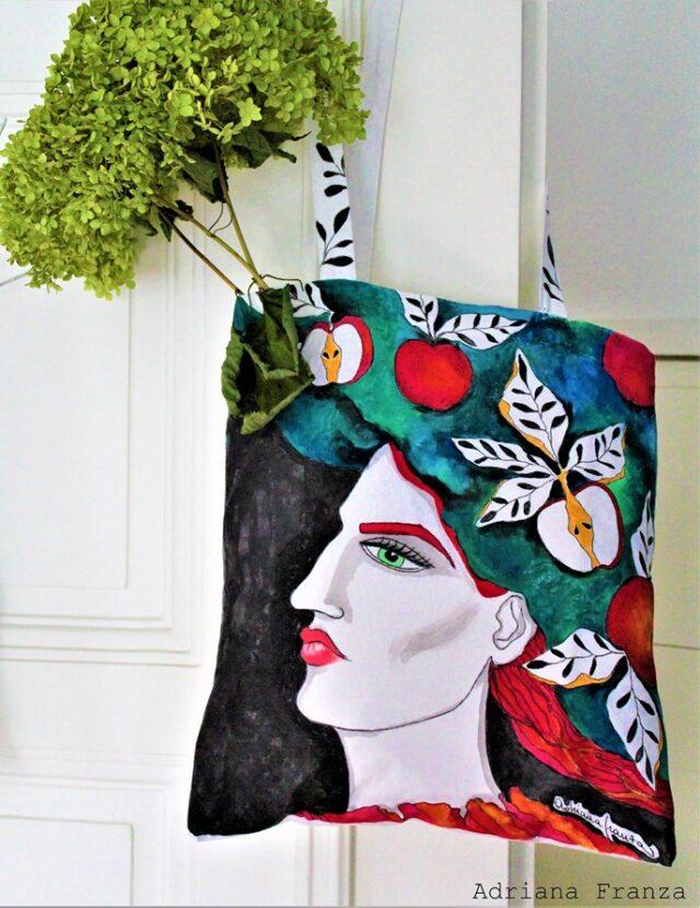 dipinto_surrealista-capelli_foglie-mele-viso_femminile_donna-preraffaelliti-borsa_colorata-borsa_dipinta_a_mano-regalo_unico